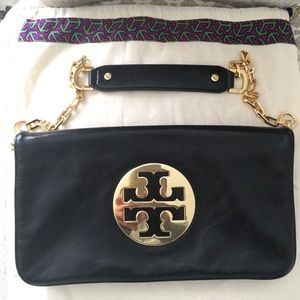 Tory Burch Black leather bag with gold chain link.